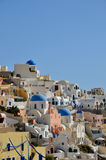 View to Santorini caldera, white houses and church domes at sunrise, Greece Stock Photos
