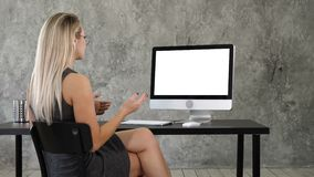 Video Call Conference Chatting Communication Concept. Lady in office talking to someone on her computer. White Display. stock footage
