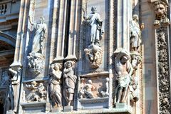 View to sculptures of Milan Duomo in sunny spring day. Stock Image