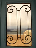 View to the sea through iron gate Stock Images