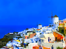 View to the sea from Oia village of Santorini island in Greece. The blurred view to the sea from Oia the most beautiful village of Santorini island in Greece Stock Photo