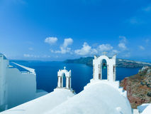 View to the sea from Oia village of Santorini island in Greece. View to the sea from church bell tower in Oia the most beautiful village of Santorini island in Stock Photo