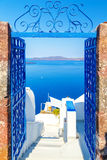 View to the sea and Volcano through door, from Fira the capital of Santorini island in Greece Royalty Free Stock Image