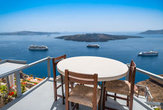 View to the sea and Volcano from restaurant of Santorini island Stock Photos