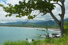 View to the seaside with the black volcanic lava beach in Jaco, Costa Rica. Stock Image