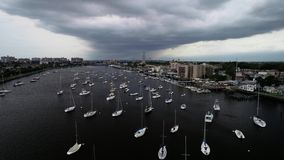 View to Sheepsheadbay area in Brooklyn, NY from the drone with effective clouds at sunset time in New York stock footage