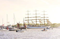 View to a ship parade in the evening sun or sunset Royalty Free Stock Images