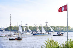 View to a ship parade with Hamburg flag in the foreground. Royalty Free Stock Photos