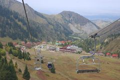 View to the Shymbulak ski station from the cable car in Almaty, Kazakhstan. Royalty Free Stock Photo