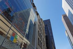 View to the sky through the skyscrapers. NEW YORK CITY, USA, September 10, 2017 : In the streets of Manhattan. Manhattan is the most densely populated borough of Stock Photography