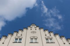 View to the sky and the top of a white magnificent historical building in the Maximilian street in Augsburg, Germany royalty free stock photo