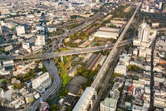 View to skyline of Bangkok in late afternoon with highways and Stock Images