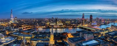 View to the skyline of London by night. From Tower Bridge along the Thames river to Westminster Palace stock photo