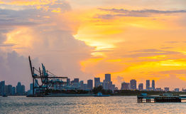 View to the skyline of Miami with docks in the foreground at sunset Stock Photos