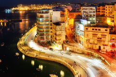 View to Sliema district over Spinola Bay shore. MALTA - JANUARY 20 2015: View to Sliema district over Spinola Bay shore with residential buildings and bars. St Stock Photo