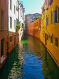 View to small channel with old buildings at Venice Stock Images