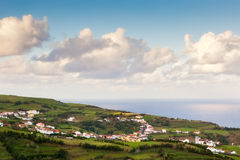 View to small city, Azores, Portugal. View to small town near atlantic ocean under heavy clouds, Azores, Portugal Royalty Free Stock Photos