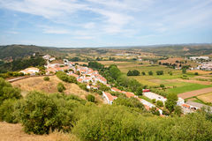 View to small town of Aljezur with traditional portuguese houses and rural landscape, Algarve Portugal. View to the small town of Aljezur with traditional Royalty Free Stock Photo