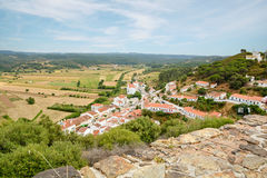 View to small town of Aljezur with traditional portuguese houses and rural landscape, Algarve Portugal. View to the small town of Aljezur with traditional Stock Photo