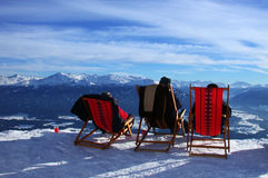View to snow. Three sunchairs looking into snowland Stock Image