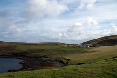 View to some houses. Scotish farm houses in the landscape stock images