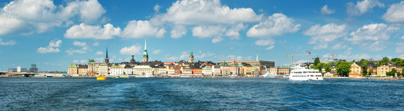 View to Stockholm with a ferry from sea. View to Stockholm, Sweden with a ferry from sea in summer. Gamla Stan on sunny day Royalty Free Stock Photography