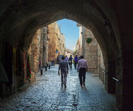 View to the street through arch in the old city of Jerusalem. Stock Photo
