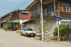 View to the street with traditional residential buildings in Chiang Khan, Thailand. Stock Photos