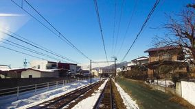View to suburb from train or railway in japan. Transportation and travel concept - view to suburb of nagano from moving train or railway in japan stock footage
