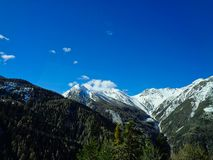 view to the swiss alps and snowy mountains royalty free stock image
