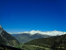 view to the swiss alps and snowy mountains stock image