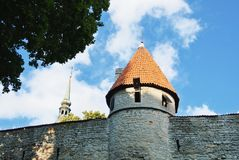 A view to Tallin Old Town walls with a tower and steeple of Sain Stock Photos
