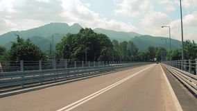 View to the Tatra mountains from the car bridge stock video footage