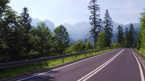 View to the Tatra mountains from the curvy car road. Spectacular view to mountains from the curvy car road. 4K gimbal stabilized travelling shot stock video footage