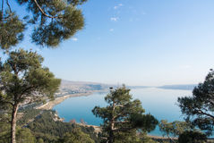 A view to Tbilisi reservoir. Near the town from a hill covered with pines, Georgia, Caucasus mountains Royalty Free Stock Photography