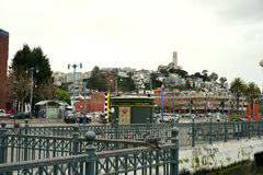 View to Telegraph Hill and Coit Tower. Travelers to the San Francisco, California ferry port in the Embarcadero neighborhood view everything from banks and Royalty Free Stock Photo