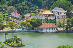 View to the Temple of the Tooth (Sri Dalada Maligawa) with golden roof reflecting the sun in Kandy, Sri Lanka. Stock Photo