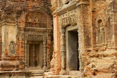 View To The Wall Carving At The Ruins Of The Preah Ko Temple In Siem Reap, Cambodia. Royalty Free Stock Images