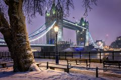 View to the Tower Bridge of London on a cold winter evening. With snow stock photography