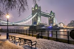 View to the Tower Bridge of London on a cold winter night. With snow Royalty Free Stock Photos