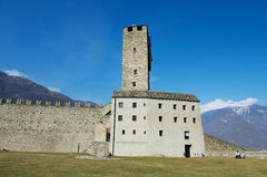 View to the tower of the Castelgrande castle in Bellinzona, Switzerland. Stock Photos