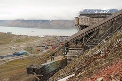 View to the town of Longyearbyen with the abandoned coal mine at the foreground, Norway. Royalty Free Stock Photo