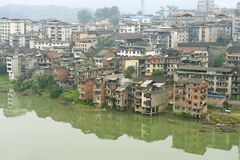 View to the town of Rongshui in Guangxi across the river in Rongshui, China. Royalty Free Stock Image