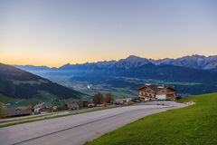 View to the town Weerberg in ustria with Inn valley. And Karwendel mountains in the evening royalty free stock photo
