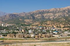 View to the town of Yasuj with the mountains at the background in Yasuj, Iran. Stock Photo
