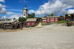 View to the traditional wooden houses and church bell tower of the copper mines town of Roros in Roros, Norway. Royalty Free Stock Image