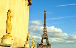 View to Trocadero golden sculptures and Tour Eiffel in sunny summer day. Royalty Free Stock Photos
