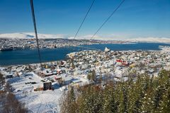 View to the Tromso city from the Fjellheisen aerial tramway cabin in Tromso, Norway. royalty free stock photos