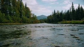 View to ural mountains. View to mountains from middle of river stock video