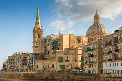 View to Valetta city buildings under sunlight Stock Photos